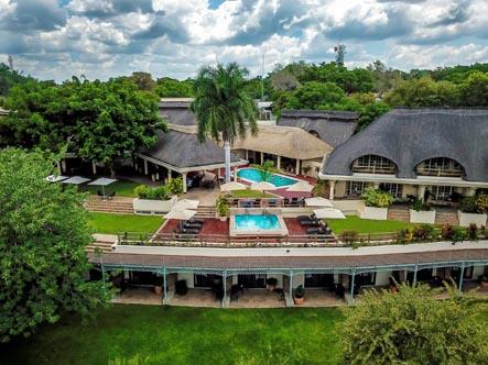 Ilana-Lodge_Hotel-Aerial-with-pools.jpg