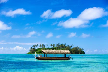 Pacific-Resort-Rarotonga-Boat-in-lagoon-2.jpg