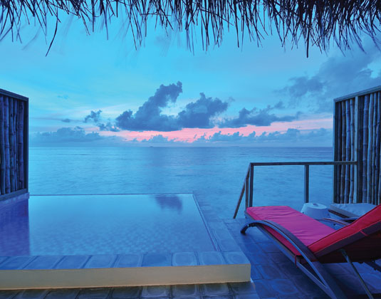 OBLU_by_Atmosphere_at_Helengeli_-_Lagoon_Villa_Sunset_View_from_Deck.jpg