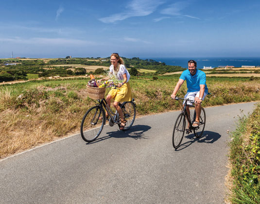 Couple cycling in Guernsey