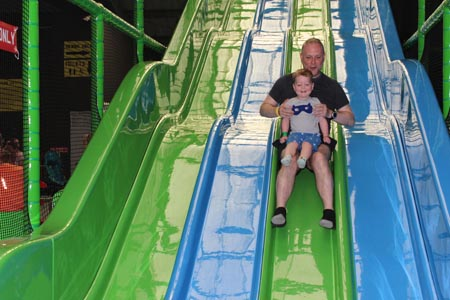 Les-Ormes_man-and-child-on-slide.jpg