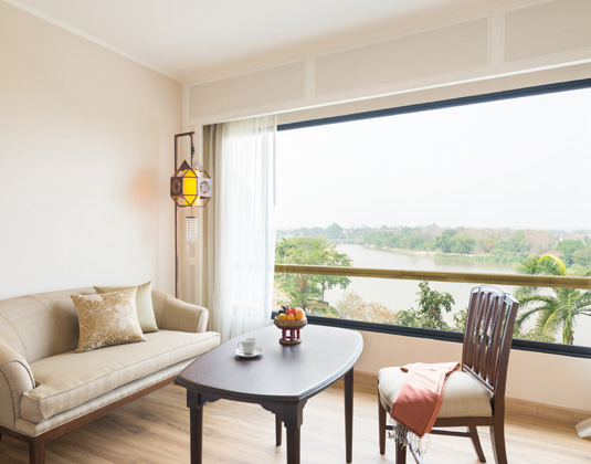Riverie_by_Kata_Thani_-_Deluxe_river_view_room_balcony.jpg