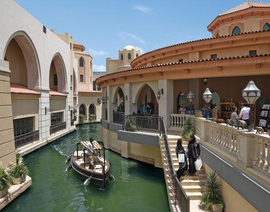 Shangri-La_Al_Qaryat_Al_Beri_-_Souk_with_abra_driver.jpg