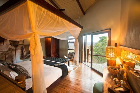 Rhino-Ridge-Safari-Lodge-Safari-Room-Interior-from-behind-bed-looking-out.jpg