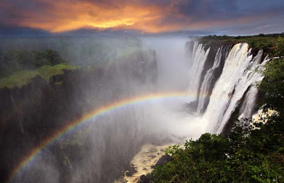 Victoria_Falls_sunset_with_rainbow,_Zambia_shutterstock_129335261.jpg