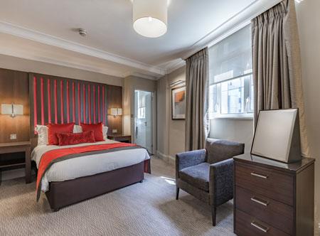 Grand-Hotel-Jersey_Ocean-View-Suite-Bedroom.jpg