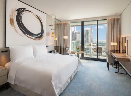 Address-Beach-Resort_Deluxe-King-Balcony-Bedroom-Marina-Facing-11.jpg