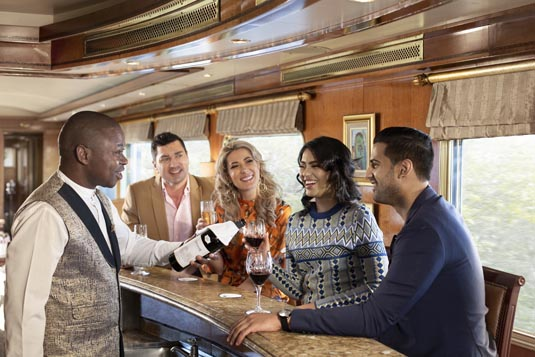 Blue-Train_Guests-being-served-champagne-at-bar.jpg