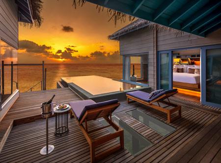 Raffles-Maldives-Meradhoo_Sunset-overwater-villa.jpg